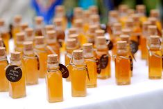 mini bottles of honey used as wedding escort cards and as favors