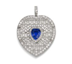 A sapphire and diamond pendant, by Cartier, circa 1910  The heart-shaped sapphire in a border of old brilliant-cut diamonds suspended from a delicately articulated openwork lattice within a further border of similarly-cut diamonds, signed, French assay marks, diamonds approximately 2.65 carats total, length 5.2cm