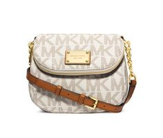 """Small in size, big on style. This petite powerhouse from MICHAEL Michael Kors lends a luxe look to your on-the-go accessorizing. Logo-splashed with a custom-fit strap, a gleaming MK plaque offers a signature finish.�Imported�MK Signature PVC�Adjustable crossbody strap with 22""""-24"""" drop�Magnetic closure�Exterior features gold-tone hardware, logo plaque and 1 zip pocket�Interior features 1 open pocket and 1 zip pocket�8"""" W x 6-1/2"""" H x 2"""" D..."""