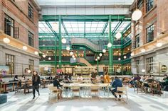 Nestled in a turn of the century brick building that was once a warehouse for the East India company, a rumored opium factory in the 1930s, and an artists' residence in the mid-2000s, WeWork Weihai Lu is surrounded by an old residential district in the heart of Shanghai.