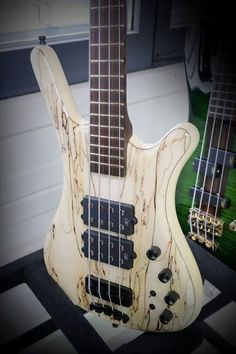 """Five string bass in white, brown wood grain streaks: Framus & Warwick Corvette, 3/8"""" Spalted Maple A Albino High Polish. RESEARCH- INSTRUMENTS FOR JOY https://www.pinterest.com/DianaDeeOsborne/instruments-for-joy - Framus factory produced  1946- 1970s classical violins, Attila Zoller guitars, & the legendary Star Bass. Mseum shows unique variety for this German instrument manufacturer. As a precursor to industrial guitar production in Europe. Framus created array of innovations…"""