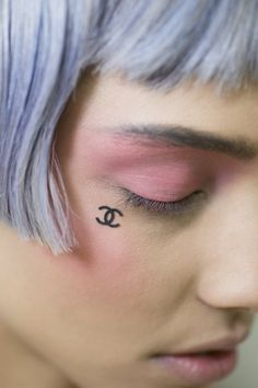 Peter Philips makes pink eyes covetable as an everyday look with less mascara and an all over pink eyeshadow.