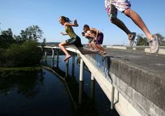 "<b>Jump off a ramp:</b> In the summer, make the leap from one of the ""ramps to nowhere"" in the Arboretum, <a href=http://www.seattlepi.com/local/article/520-ramps-to-nowhere-to-be-demolished-4221870.php>before they're torn down</a>. (Warning: the ramp is higher from the water than it appears in this photo, so muster courage)."