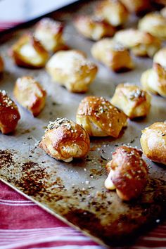 pretzel bites stuffed with cheese and topped with rosemary salt