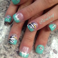 Seafoam French Nails With Flower Accents, White Bow Detail, and Rhinestones.