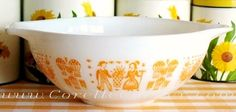 I am totally geeking out here. This website has a timeline of when every Pyrex color, shape, and pattern was introduced! (pictured: 444 Cinderella bowl, orange Butterprint)