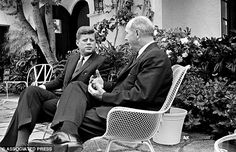 President John F. Kennedy listens to Secretary of State Dean Rusk as they sit together at the Palm Beach home in 1961. (Palm Beach, Florida)