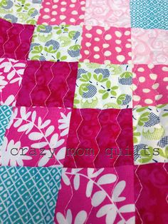 This quilting technique uses a walking foot and a very elongated zigzag stitch. Brilliant.