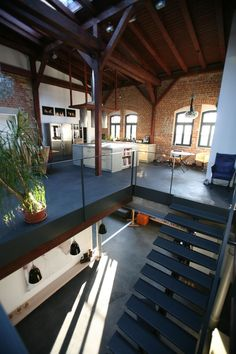 so inviting for clients, modern, exposed brick, open, wood, stairs, loft in Leipzig
