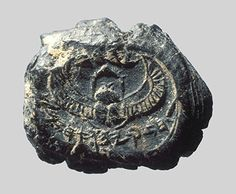 """This clay seal impression from c. 700 BC contains the Hebrew text,  """"Belonging to Hezekiah [son of] Ahaz, King of Judah."""" Hezekiah is a well known Biblical king referred to frequently in such passages as 2 Kings 19:9. The impression shows a winged scarab beetle, which possibly indicates Egyptian artistic influence. The artifact is roughly one-half inch in size and is now in a private collection."""