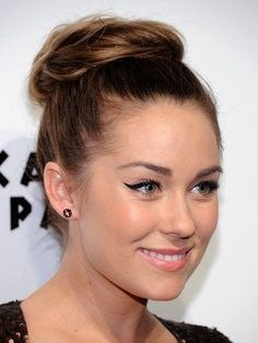 Lauren Conrad topknot hairstyle and cat eye | allure.com