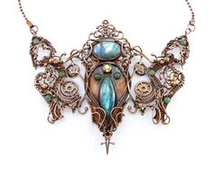"""""""Flight of the Valkyrie"""" -- Labradorite & Aventurine cabochons w/ Faceted Citrine gemstone, citrine & copper beads along w/ steampunk gears. Original design & creation by Daryl Adams of Adams Handcrafted Jewelry."""