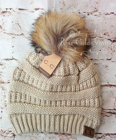 A little twist on the popular CC beanie hats - a faux fur pom pom on top!  Available in 10 fabulous winter colors - the perfect winter accessory!  100% Acrylic,