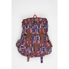 Urban Outfitters Canvas Backpack Sturdy canvas backpack from Ecote topped with an all over print. Distressed faux-leather trim. Antiqued hardware; magnetic snap and drawstring closure. Lined main compartment with a zip pocket and organizer pouches. Front, back, side and outer pockets. Adjustable shoulder straps. Right strap has wear and tear which is pictured. Priced accordingly. Urban Outfitters Bags Backpacks