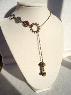 Steampunk Pyrite Filled Bronze Capsule & Gear Lariat Necklace. $20.00, via Etsy.