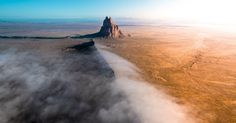Early morning fogs rolls over this historic rock formation in Shiprock, New Mexico in one of our top picks for the Nature category this week. Don't miss your chance to submit. #flights & #hotels #Cruises #RentalCars #mexico #lajolla #nyc #sandiego #sky #clouds #beach #food #nature #sunset #night #love #harmonyoftheseas #funny #amazing #awesome #yum #cute #luxury #running #hiking #flying