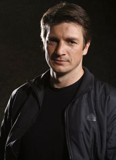 Adorable and charming Nathan Fillion. I love him as Castle. Such charm and boyishness.