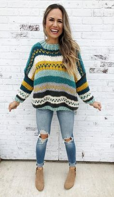 Step up your cold weather game in this Calgary hand knit sweater. This chunky knit is a fresh twist on a retro style sweater. 100% Acrylic Model: She is 5ft 7in and a size 2. She is a 34D and is wearing a Small. Comes in Mint and Rust