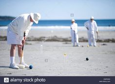 Download this stock image: A group of people playing croquet on the beach - EWPGD0 from Alamy's library of millions of high resolution stock photos, illustrations and vectors.