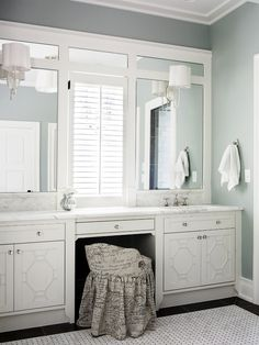 inset mirrors, fretwork cabinets (by brian watford via houzz)