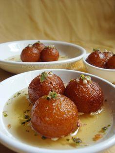 Gulab Jamun - Deep Fried Dumplings - Made with milk powder soaked in sugar syrup. Indian Dessert Recipes, Indian Sweets, Indian Snacks, Sweet Desserts, Sweet Recipes, Eggless Desserts, Baking Desserts, Jamun Recipe, Gulab Jamun