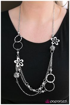 Shake it Up an adorable multilayered necklace accented by flowers. With matching earrings.  $5