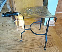 Brass & iron trivet stand for sale at More Than McCoy; (not antique, but would fit in well with Victorian accessories).