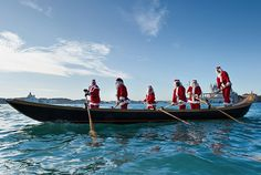 Venice, Italy: Rowers dressed as Father Christmas row a gondola from St Mark's to the island of San Giorgio Maggiore #irresistiblyitalian
