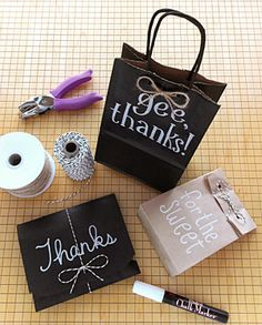 Learn how to use chalk markers on our black gift bags for a chalkboard look!  http://www.nashvillewrapscommunity.com/blog/2012/08/how-to-gift-wrap-with-a-chalkboard-look/#