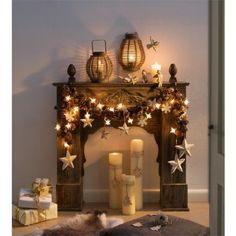 So pretty for those who have a mantel - gives the look of a fireplace for sure. I'd add some red berries, just simple real ones if possible -