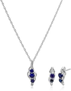 "Sterling Silver Created Blue Sapphire and Diamond Accent Heart Earrings and Pendant Necklace Jewelry Set, 18"". Two-piece set featuring diamond-accented pendant necklace with three faceted heart-shape created gemstones. 18"" Rope chain with spring-ring clasp. Set includes matching stud earrings with diamond accents and total four heart-shape created gemstones. All our diamond suppliers confirm that they comply with the Kimberley Process to ensure that their diamonds are conflict free…"