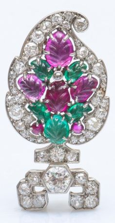 An Art Deco white gold, gem-set and diamond 'Tutti Frutti' brooch, by Cartier Paris. Set with old-cut diamonds and carved emerald and ruby leaves mounted in 18k white gold. Signed Cartier Paris. 3.6 x 2cm. #Cartier #ArtDeco #brooch