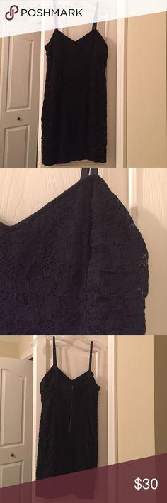 Forever21 black dress Forever 21 black spaghetti strap dress, visible back zipper. Rouching/flower detail. Forever 21 Dresses Mini
