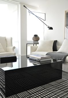 (i just purchased a black glass side table similar to this) this room is such a beautiful balance of masculine and feminine, sleek and modern, soft and elegant.