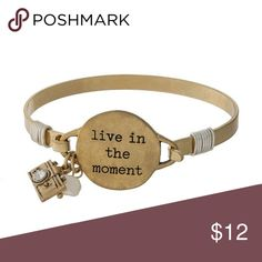 """""""Live in the moment"""" gold tone bracelet Metal bangle bracelet with a circle focal stamped with """"live in the moment"""" and camera charm ⭐️NEW IN PACKAGING ⭐️SHIPS SAME/NEXT DAY ⭐️10% DISCOUNT ON BUNDLES OF 3+ ⭐️FREE GIFT W/PURCHASE OVER $40 ChicbytheBeach Jewelry Bracelets"""