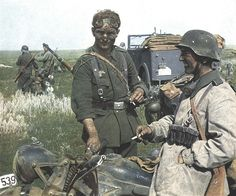German motorcycle troops of the Großdeutschland division, full of dust. (near Don river,1942. Rare color picture.