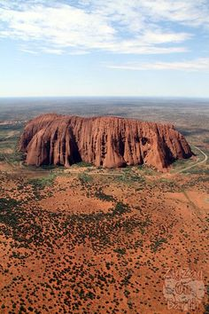 Helicopter flight over Uluru - incredible how flat it is around it, no? - click for more photos