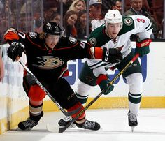Hampus Lindholm #47 of the Anaheim Ducks skates against Charlie Coyle #3 of the Minnesota Wild