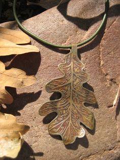 etched metal jewelry  autumn oak leaf  beautiful seasonal necklace. $22.00, via Etsy.