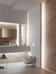 Bad modern gestalten mit Licht Modern bathroom design by indirect lighting as a secondary light Small bathroom designBathroom design with BluModern bathroom, white Modern Bathroom Design, Bathroom Decor, Interior, Beautiful Bathrooms, Natural Stone Wall, Home Decor, House Interior, Bathroom Design, Contemporary Bathroom