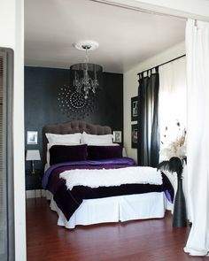 Layered colours and textures on the bed against a nice backdrop wall colour