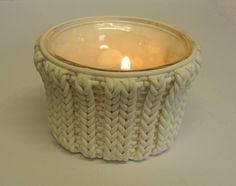 """faux cabled candle holder. by ClaireWallis, """"knit"""" polymer clay and glass"""