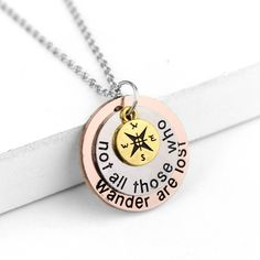 Imprinted with the wise words of J. R. R. Tolkien, this triple pendant necklace makes a perfect gift for someone who's spirit is full of wanderlust. Let this inspiring quote help guide you through all