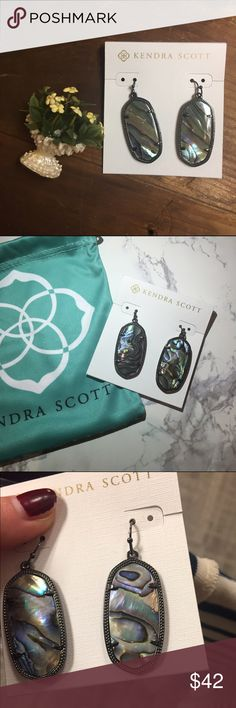 {Kendra Scott} NWT Abalone Elle Gunmetal Earrings ❃ new with tags ❃ 100% authentic ❃ gunmetal filigree  x trades ✓ offers ✓ bundles  Love the danielle style but not the weight? You're in luck! Custom oval stones in a thin metallic frame, the abalone and gunmetal elle earrings are a perfect match for any ensemble! With the with gunmetal filigree detail and natural stone variation, you'll want these earrings in every color. The versatile gunmetal backing makes wearing suitable for night and…