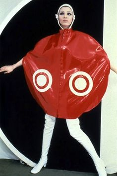 Pierre Cardin plastic cape Cardin experimented with unique materials, and was associated with the space age style of the 60's. This look features a plastic suit with a helmet (space age)