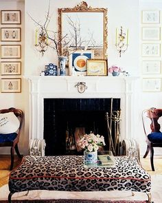 Keep with a traditional-leaning look by adding a set of classic brass fire tools and a sprinkling of blue-and-white accessories.