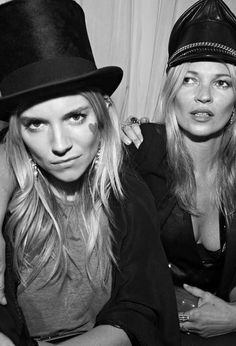 Kate Moss being photo bombed by Sienna Miller.