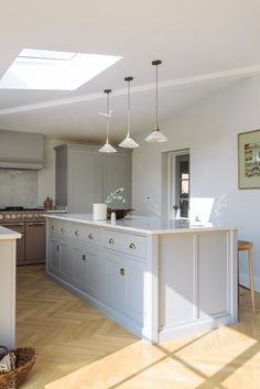 herringbone wood floor with gray shaker kitchen cabinets Grey Shaker Kitchen, Shaker Kitchen Cabinets, Kitchen Cabinet Design, Kitchen Decor, Kitchen Wood, 2 Colour Kitchen Cabinets, Kitchen Ideas, Distressed Kitchen, Neutral Kitchen