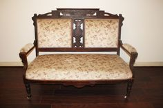 floral and wooden loveseat