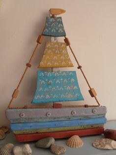 Sail away with me, in one of my driftwood boats. By Philippa Komercharo.